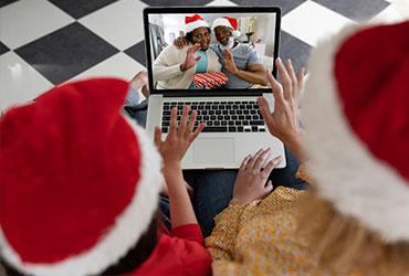 Children talking with family members over the internet on Christmas
